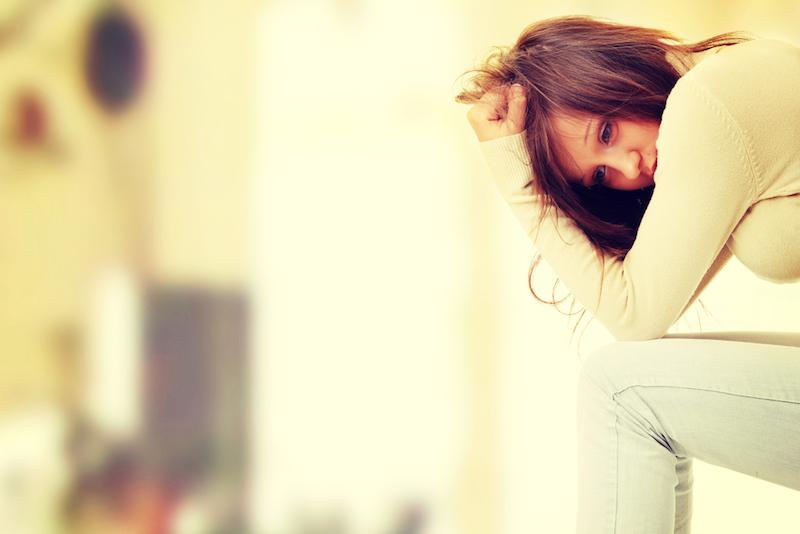 Yoga-gegen-Panikattacken-Frau-deprimiert